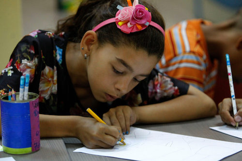 Bulgarian Roma girl aged 10 draws at a child zone supported by UNICEF in Sliven